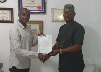 Rev. Samuel Ikpea presenting the Sponsorship deal package to Mr. Joseph Odoekwu in Lagos