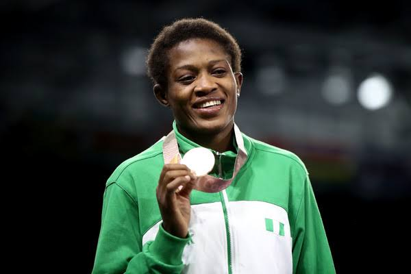 Odunayo Adekuoroye pose with her gold medal. PHOTO CREDIT: Realnews Magazine