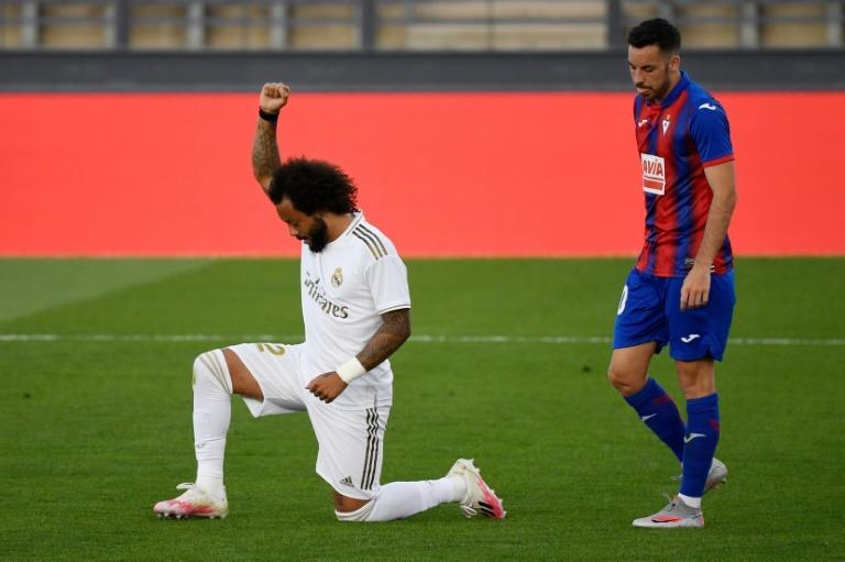 Marcelo kneels after scoring against Eibar on first game after coronavirus break Photo Credit: AFP.COM