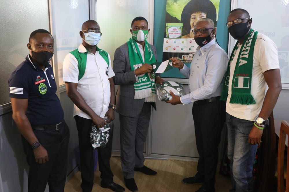 Rev. Samuel Ikpea of NFSC receives the facemasks from Mr O'brien of SoulMate Industries Photo credit: www.simag.com.ng