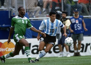 Argentina versus Nigeria at the 1994 World Cup Football Championships. Uche Okechukwu (Nigeria) and Diego Maradona (Argentina). (Photo by Jérôme Prevost/TempSport/Corbis/VCG via Getty Images)