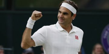 Tennis - Wimbledon - All England Lawn Tennis and Croquet Club, London, Britain - July 5, 2021 Switzerland's Roger Federer celebrates winning his fourth round match against Italy's Lorenzo Sonego REUTERS/Paul Childs